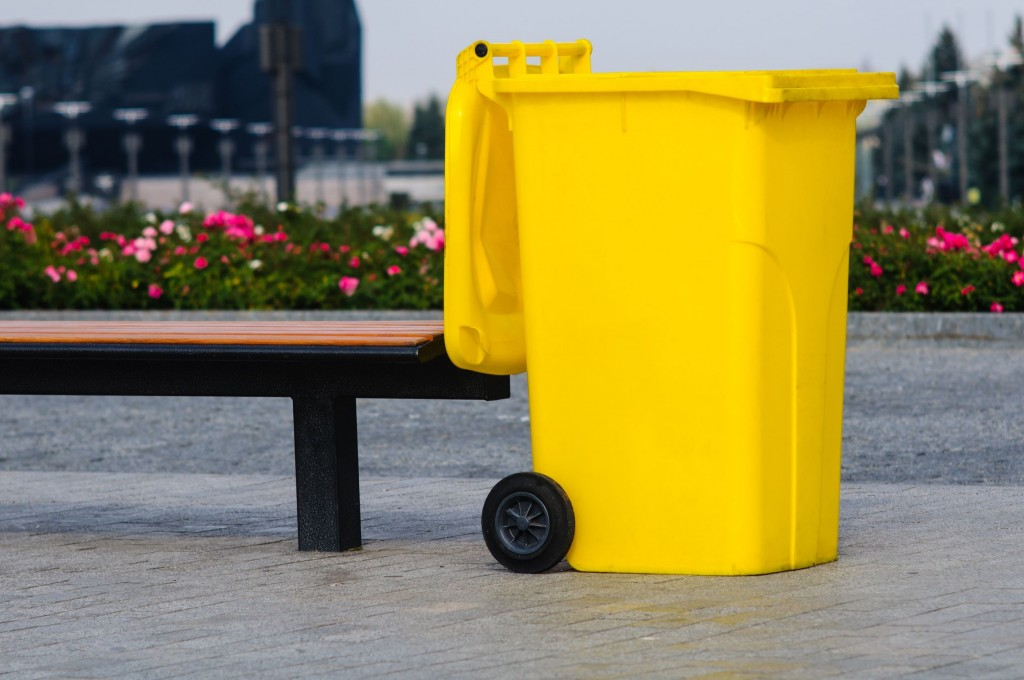 15704169 - big yellow recycling container in the park