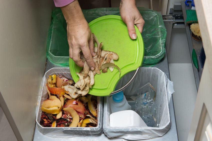 49152740 - household waste sorting and recycling kitchen bins in the drawer. collecting food leftovers for composting. environmentally responsible behavior, ecology concept.