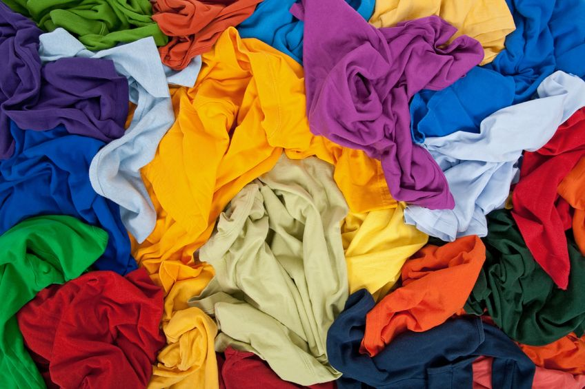 8321733 - lots of bright messy colorful clothing, abstract background.