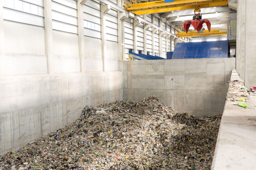 53572356 - inside of a waste management facility. treatment and disposal of waste. prevention of waste production through in-process modification, reuse and recycling. convert waste materials into new products.
