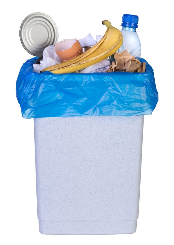 21151820 - bin full of rubbish isolated on white background